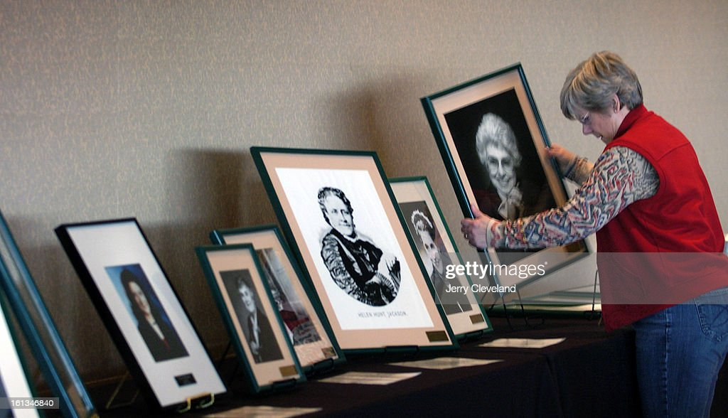 DENVER, COLO. - MARCH 9, 2006 - Nancy Mucker<cq> arranges a portrait of Miriam Goldberg<cq>, publisher of the Intermountain Jewish News<cq> and a member of the Colorado Women's Hall of Fame<cq>, for a celebration of the 20th anniversary of the hall of Fam : News Photo