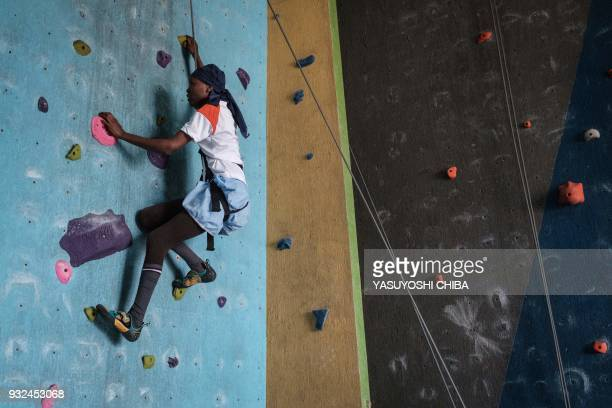 TOPSHOT Nancy Muthoni of Thika school for the Blind challenges rope climbing during a weeklong free climbing training for visually impaired and blind...