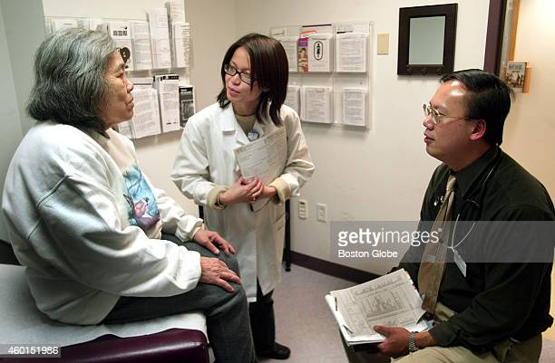 Nancy Ngo center who works in the Nuclear Medicine Dept of Quincy Medical Center serves as Vietnamese interpreter for Kheu Tran left during routine...