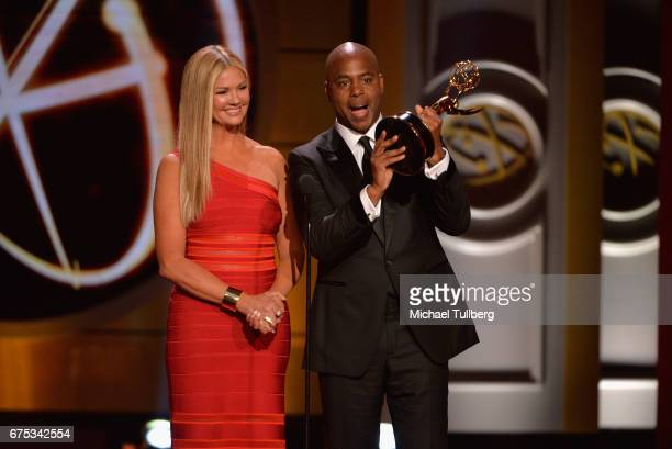 Nancy O'Dell and Kevin Frazier accept the award for outstanding entertainment news program for 'Entertainment Tonight' at the 44th annual Daytime...