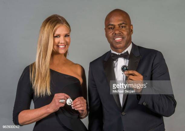 Nancy O'dell and Kevin Frazier pose with TAP medallion at 45th Daytime Emmy Awards Portraits by The Artists Project Sponsored by the Visual Snow...