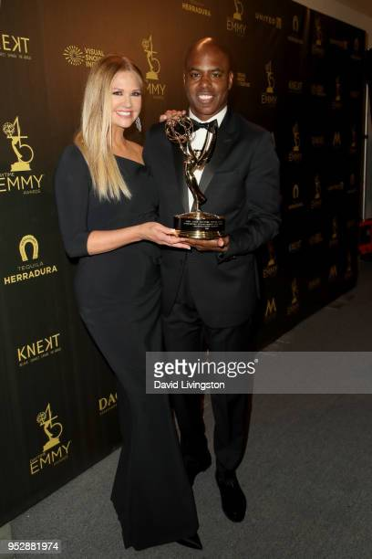 Nancy O'Dell and Kevin Frazier winners of Outstanding Entertainment News Program for 'Entertainment Tonight' pose in the press room during the 45th...