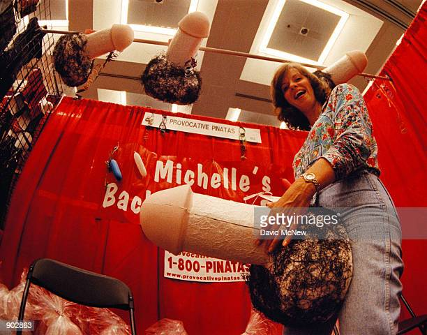 Nancy Pearlman shows off her penisshaped pinata which she designed at the Erotica LA convention June 11 1999 in Los Angeles Pinatas come in many...