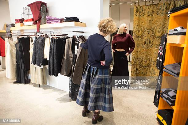 Nancy Pearlstein owner of Relish pulls garments for a customer Jennifer Peacock and awaits feedback about the garment