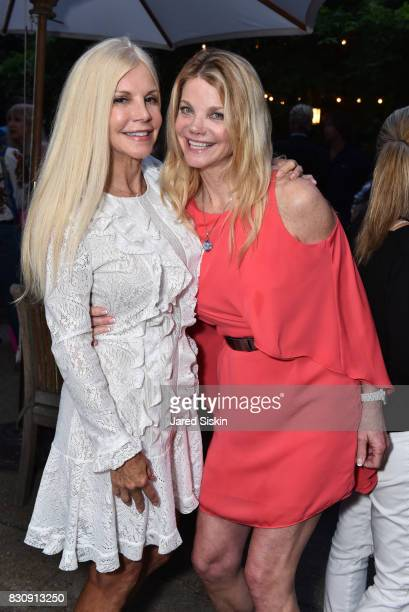 Nancy Pearson and Gwendolyn Beck attend AVENUE on the Beach's Summer Soiree at The Baker House on August 12 2017 in East Hampton New York