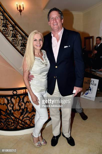 Nancy Pearson and John Regan attend Katrina and Don Peebles Host NY Mission Society Summer Cocktails at Private Residence on July 7 2017 in...