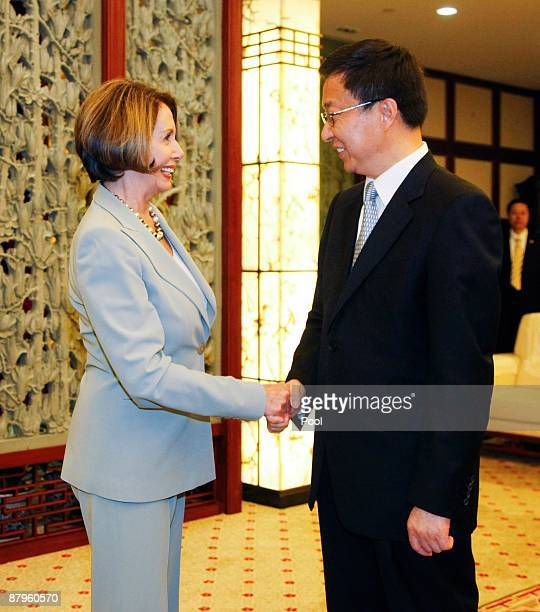 Nancy Pelosi speaker of the United States House of Representatives shakes hands with Han Zheng Mayor of Shanghai on May 25 2009 in Shanghai China...