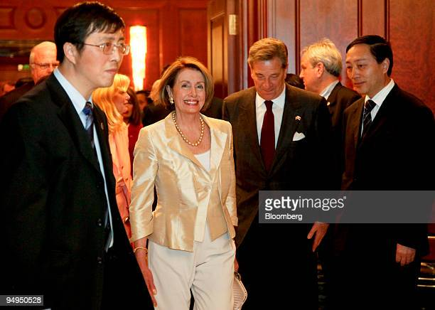 Nancy Pelosi speaker of the US House of Representatives second from left arrives for a meeting with Liu Yungeng chairman of Shanghai's Municipal...