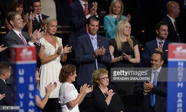 Nancy Pence Fritsch mother of Indiana Governor and US vice presidential candidate Mike Pence is applauded by her family and the Trump family during...
