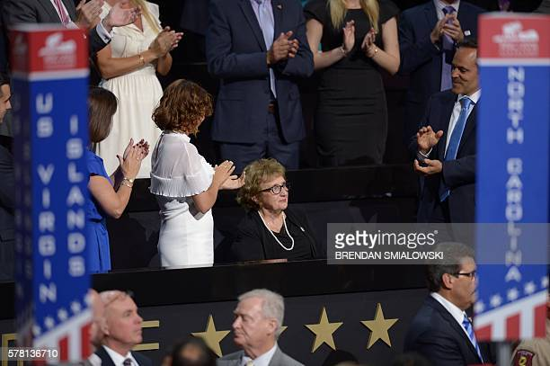 Nancy Pence Fritsch mother of Indiana Governor and US vice presidential candidate Mike Pence is applauded by her family during the third evening...