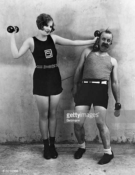 Nancy Phillips and Chester Conklin keep their girlish figures by daily exercises in the studio gym Undated movie still BPA2