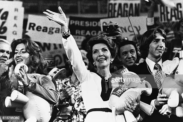 Nancy Reagan center and Ron Reagan Jr right at the 1976 Republican National Convention Reporter Mike Wallace is in the background