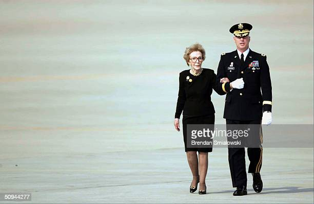 Nancy Reagan escorted by US Army Maj Gen Galen B Jackman arrives with the remains of her husband former US President Ronald Reagan on June 9 2004 at...