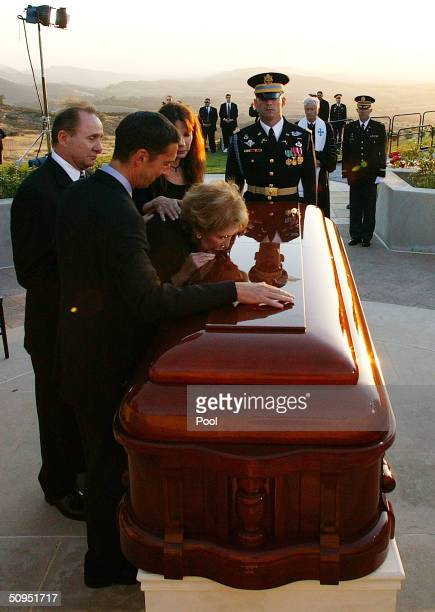 Nancy Reagan kisses the casket of former President Ronald Reagan during the interment ceremony at the Ronald Reagan Presidential Library June 11 2004...