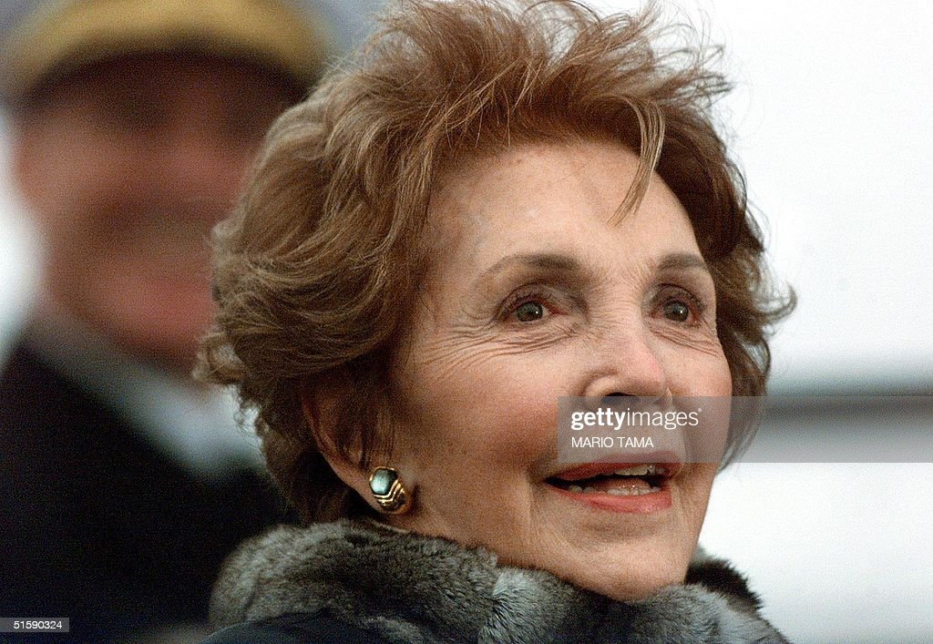 Nancy Reagan looks during speeches at the christening ceremony of the aircraft carrier USS Ronald Reagan at Newport News Shipbuilding Yard in Newport News, Virginia, 04 March 2001, the Reagan's 49th wedding anniversary. The ship is powered by two nuclear reactors and will be home to approximately 6,000 Navy personnel. AFP Photo/Mario TAMA