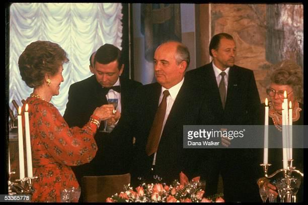Nancy Reagan & Mikhail Gorbachev raising glasses in toast during summit dinner at Grand Kremlin Palace, with Helena Shultz .