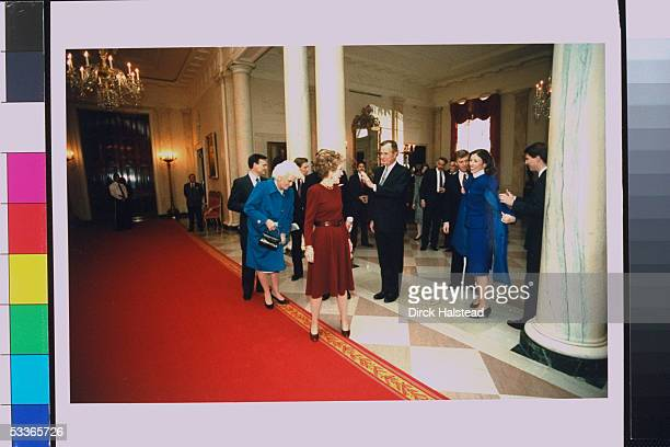 Nancy Reagan poised on red carpet inside WH flanked by Preselect Barbara Bush with others including VPelect Marilyn Quayle saying her farewells on...