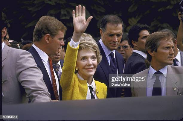Nancy Reagan surrounded by secret servicemen while in country with US Amb to Mexico John Gavin touring in wake of earthquake