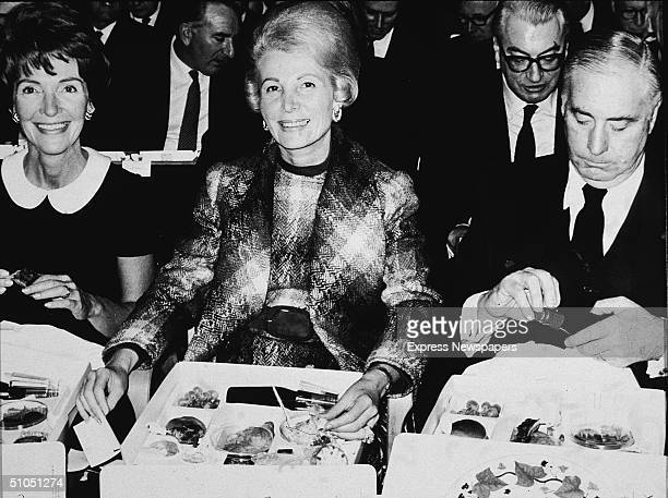 Nancy Reagan wife of California governor Ronald Reagan eats a box lunch with Leonore Anneberg and her husband US Ambassador to the Court of St James...