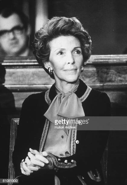 Nancy Reagan wife of California governor Ronald Reagan sits with her hands clasped on her knee at the Governor's Press Conference in the Senate...