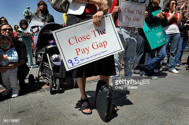 Nancy Reichman, a member of Colorado's Pay Equity Commission joins in a rally in downtown Denver, CO. Colorado citizens and activists from 9to5,...