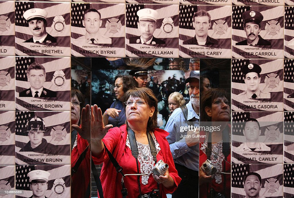 Nancy Ricci stops to touch a tile on a memorial for the 343 New York firefighters who died during the September 11 terror attacks following a service at the New York City Fire Museum on September 11, 2011 in New York City. New York City firefighters are commemorating the 10th anniversary of the 9/11 terrorist attacks and honoring the 343 firefighters who died in the line of duty.