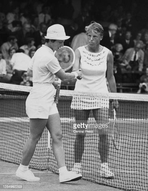 Nancy Richey of the United States congratulates Ann Jones of Great Britain with a handshake across the net after losing 63 63 in the third round of...