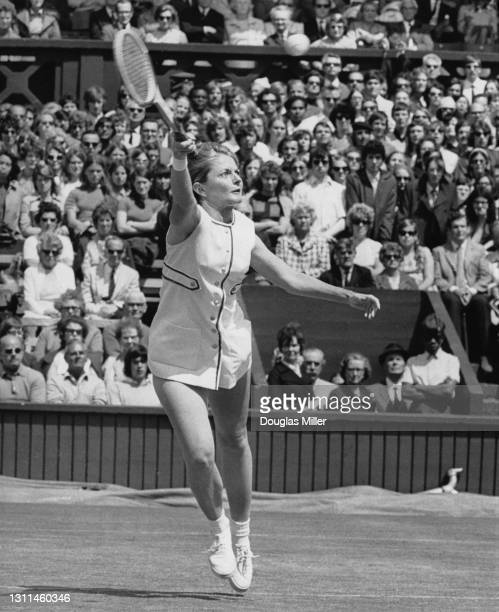 Nancy Richey of the United States reaches to make a forehand return to Evonne Goolagong of Australia during their Women's Singles Quarter Final match...