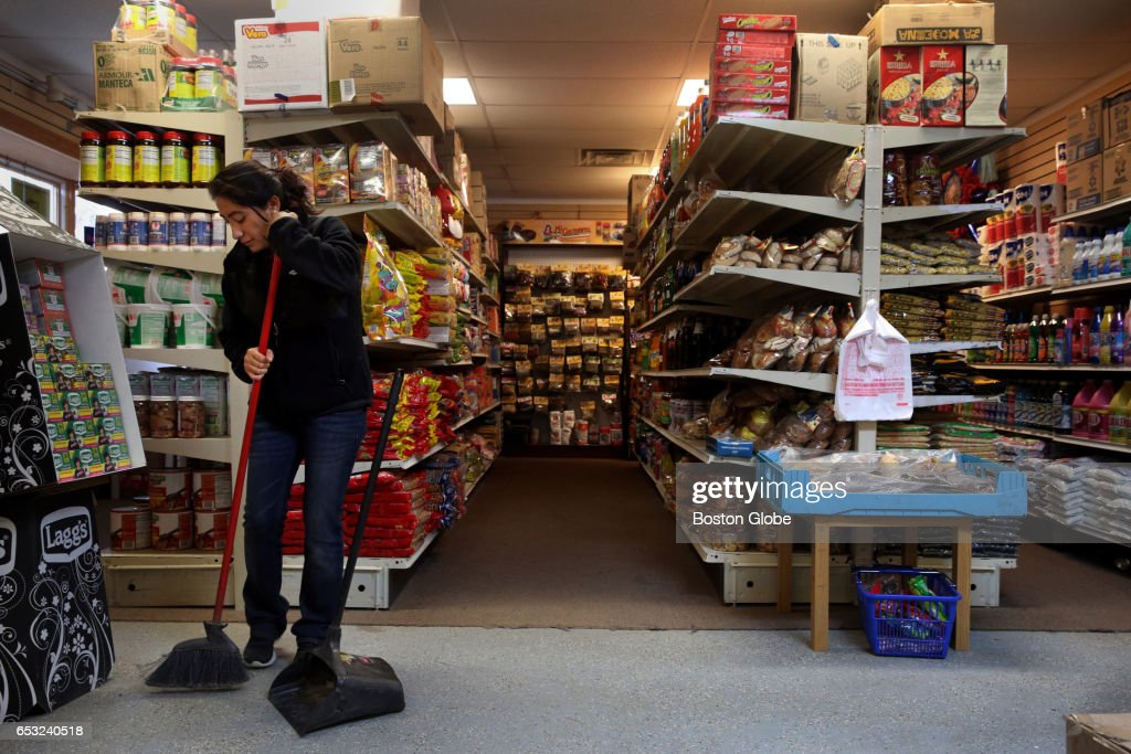 Nancy Rosario sweeps the floor at her family's market in Orleans County, NY on Mar. 7, 2017. The Rosario family operates a Costco-like retailer, specializing in Hispanic products. Piñatas hang from the ceiling, colorful boots line the wall and Spanish delicacies can be found in each aisle. The family has owned the store for nearly 11 years, catering primarily to Hispanic farmworkers in the area. As deportation fears mount among those workers, most of whom are likely undocumented, the family has seen in a spike in their delivery service. Although the family has always offered to deliver goods to workers on the farms, the service was rarely used. Now, its a necessity.