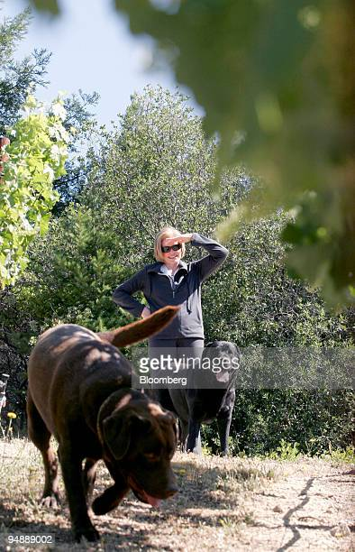 Nancy Seaver and her dogs Major and Bandy greet her husband Tom Seaver former New York Mets Hall of Fame pitcher as he prunes vines at their 3acre...