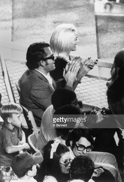 Nancy Seaver cheers after her husband Tom Seaver of the New York Mets hit a home run during the game against the Montreal Expos at Shea Stadium on...
