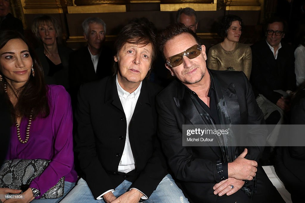 Nancy Shevell, Sir Paul McCartney and Bono attend the Stella McCartney Fall/Winter 2013 Ready-to-Wear show as part of Paris Fashion Week on March 4, 2013 in Paris, France.