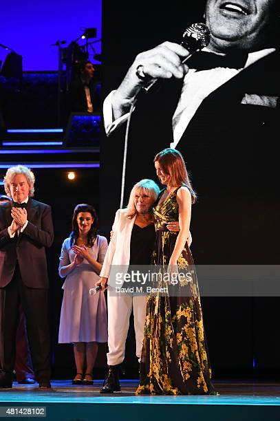 Nancy Sinatra and daughter Amanda Lambert bow at the curtain call during the press night performance of 'Sinatra At The London Palladium' at the...