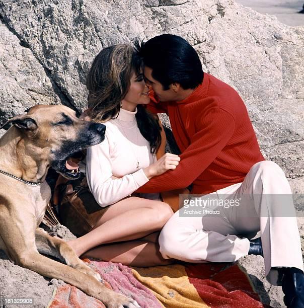 Nancy Sinatra is kissed by Elvis Presley in a scene from the film 'Speedway' 1968