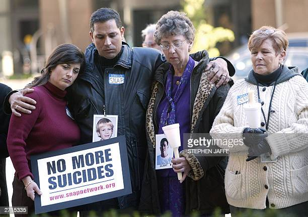 Nancy Sloan Carlos PerezCarrillo Janet Patterson and Nora Connors who were all affected by clergy abuse hold a vigil outside the hotel where the...