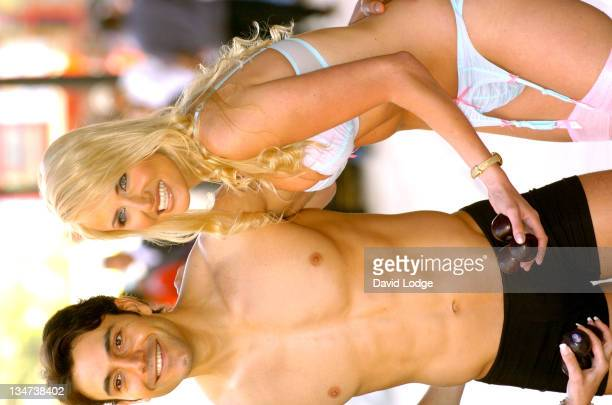 Nancy Sorrell and a male model during Nancy Sorrell Helps to Launch the Check His Plums Campaign at Anne Summers Oxford Street in London United...