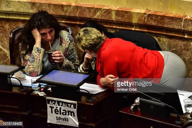 Nancy Susana Gonzalez senator for Chubut talks to Ana Maria Ianni senator for Santa Cruz as she drinks mate while senators vote for the new abortion...