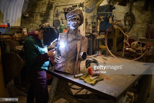 Nancy Thomson, the head of metalwork, continues her work on the torso of a statue of Nancy Astor, the first female MP, at the Bronze Age sculpture...