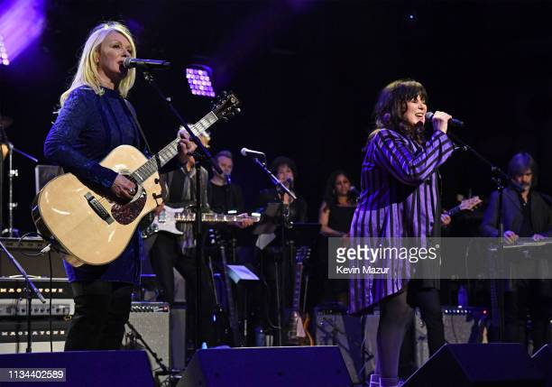 Nancy Wilson and Ann Wilson of Heart perform onstage during the Third Annual Love Rocks NYC Benefit Concert for God's Love We Deliver on March 07,...