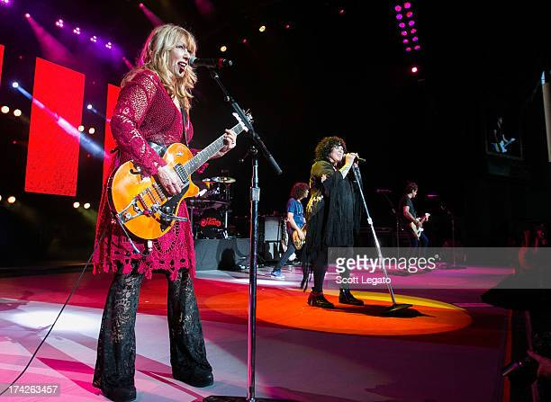Nancy Wilson and Ann Wilson of rock band Heart performs at the DTE Energy Music Theater on July 19 2013 in Clarkston Michigan