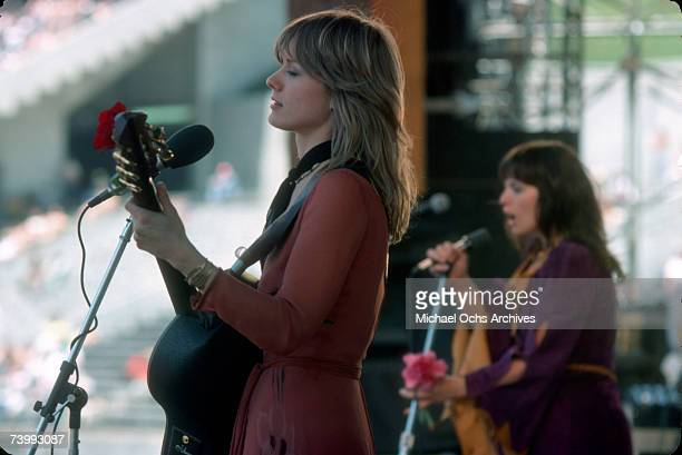 Nancy Wilson of the rock band 'Heart' performs onstage at the Oakland Coliseum on May 30 1977 in Oakland California