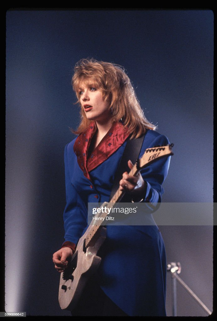 Nancy Wilson plays an electric guitar while shooting a music