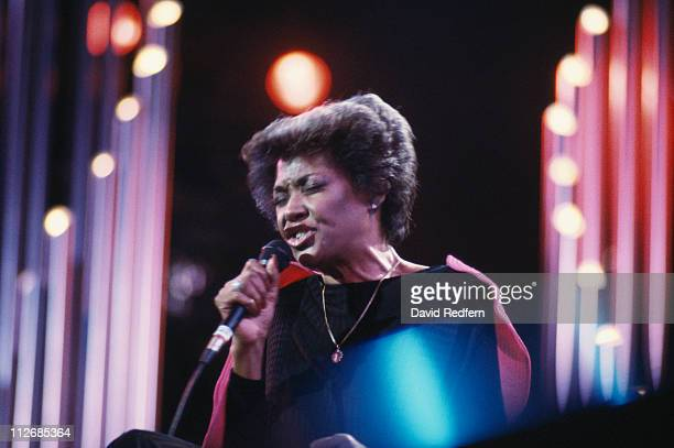 Nancy Wilson US jazz singer singing into a microphone during a live concert performance circa 1984