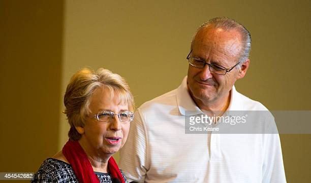 Nancy Writebol the SIM USA missionary who recovered from Ebola Virus Disease contracted in Liberia speaks at her husband David looks on at a news...