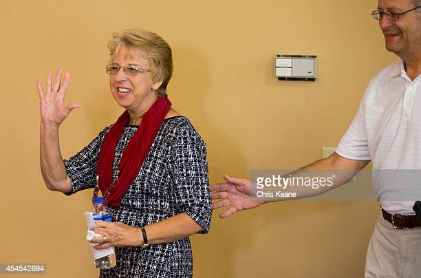 Nancy Writebol the SIM USA missionary who recovered from Ebola Virus Disease contracted in Liberia waves as she walks into a news conference at the...