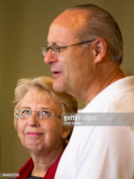 Nancy Writebol the SIM USA missionary who recovered from Ebola Virus Disease contracted in Liberia looks at her husband David as he speaks a news...