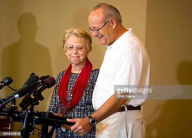 Nancy Writebol the SIM USA missionary who recovered from Ebola Virus Disease contracted in Liberia looks down as her husband David speaks a news...