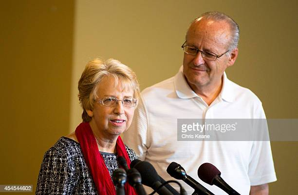 Nancy Writebol the SIM USA missionary who recovered from Ebola Virus Disease contracted in Liberia speaks as her husband David looks on at a news...