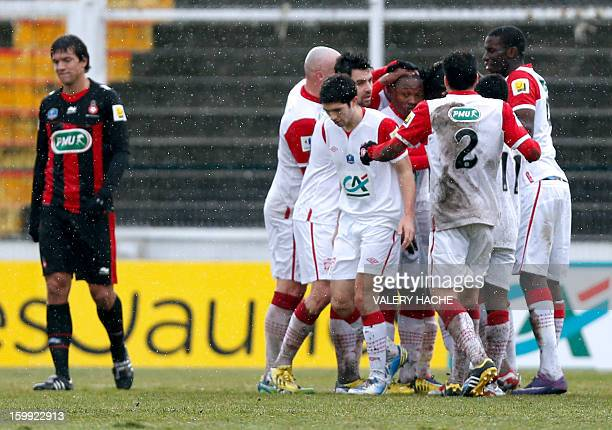 Nancy's Cameroonian forward Paul Alo'o Efoulou celebrates with team mates after scoring a goal during a French Cup round of 32 football match between...