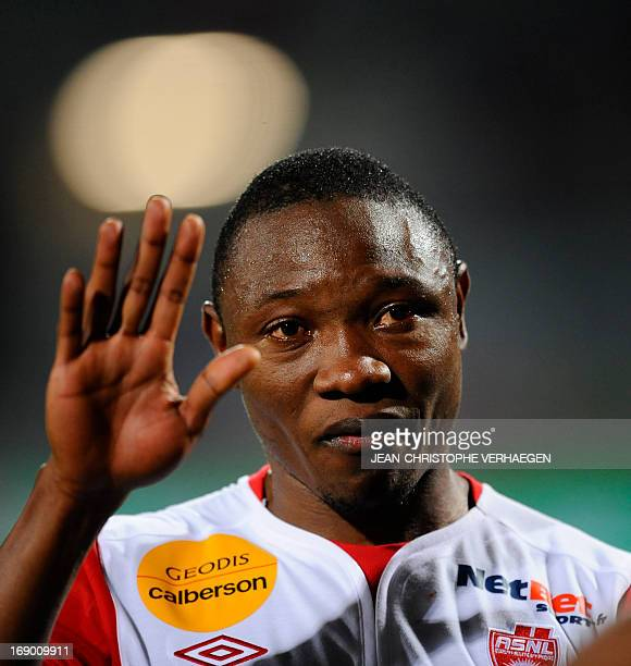 Nancy's Cameroonian forward Paul Alo'o Efoulou cries at the end of the French L1 football match Nancy vs Bastia at Marcel Picot Stadium on May 18...